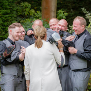 Sarah Hargreaves of Sugar Photography, West Yorkshire laughing with a wedding party