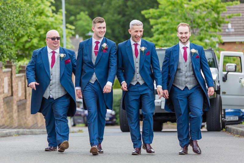 Groomsmen walking down the road