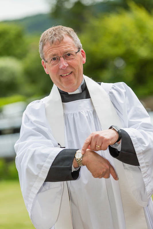 Vicar points at watch