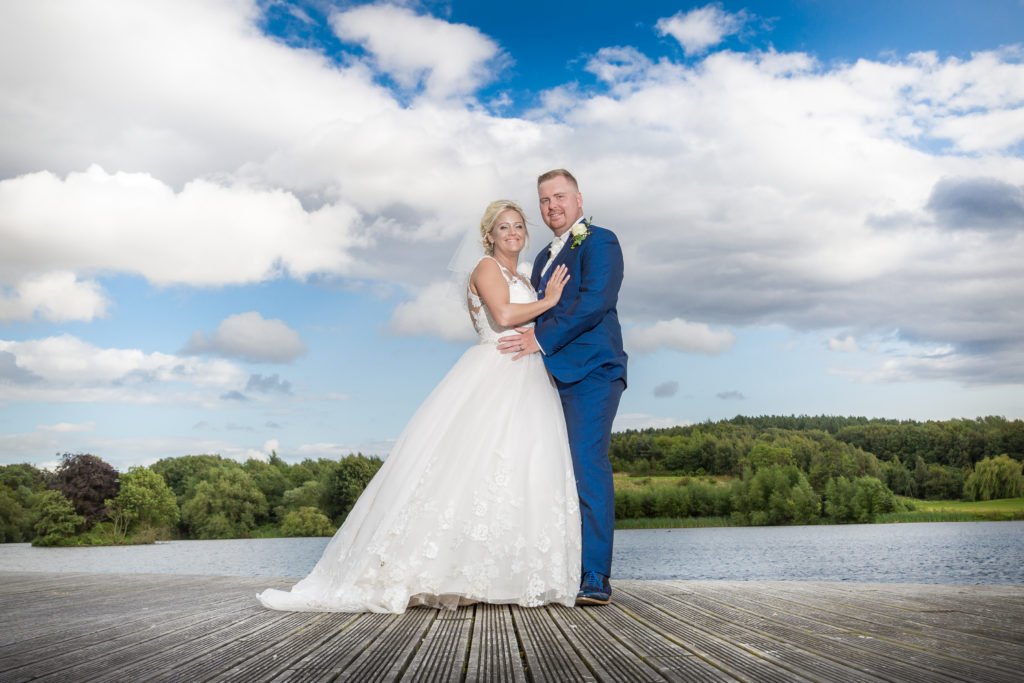 Bride and groom on a jetty