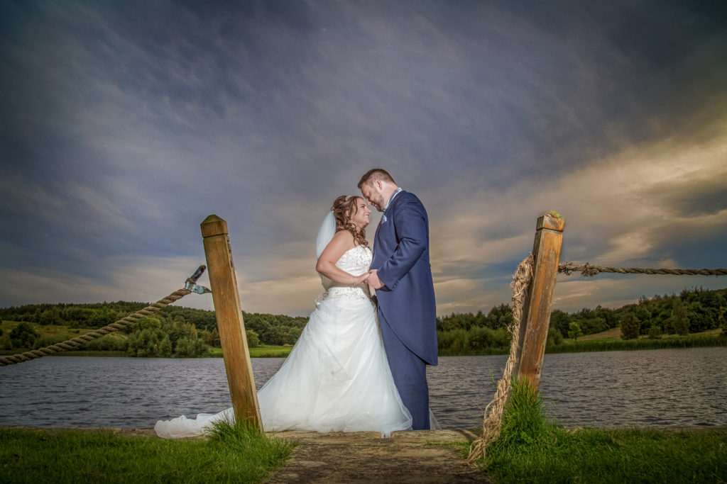 Bride and groom under stormy skies for a dramatic Yorkshire wedding
