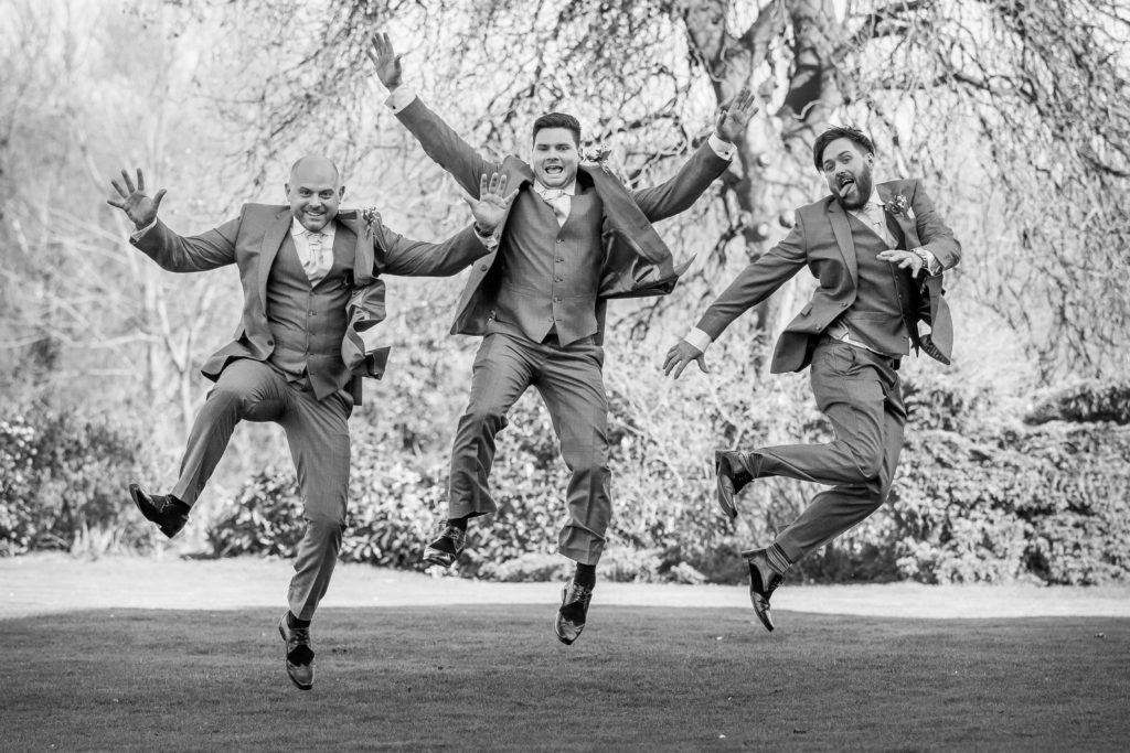 Groomsmen leaping in mono by Sarah Hargreaves of Sugar Photography