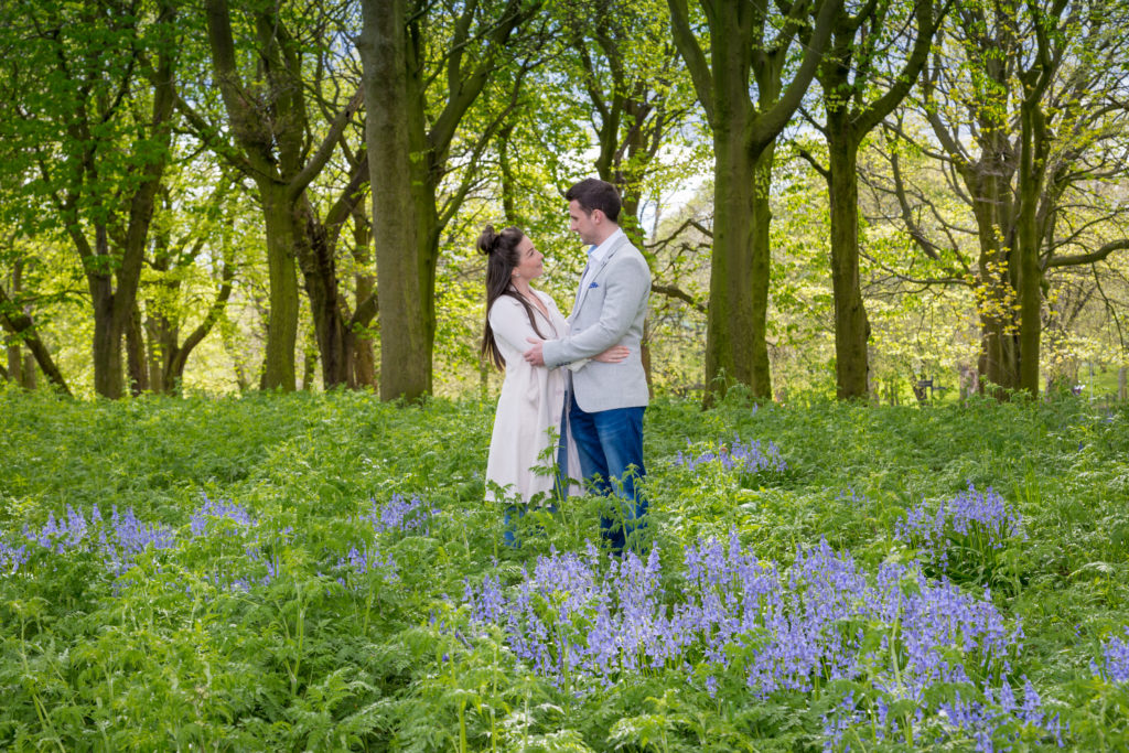 Couple stand in bluebells