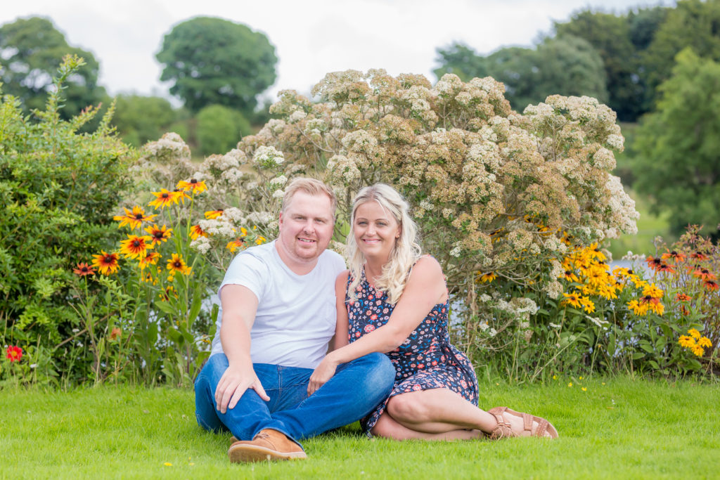 Couple pose on the grass for a romantic photoshoot in West Yorkshire