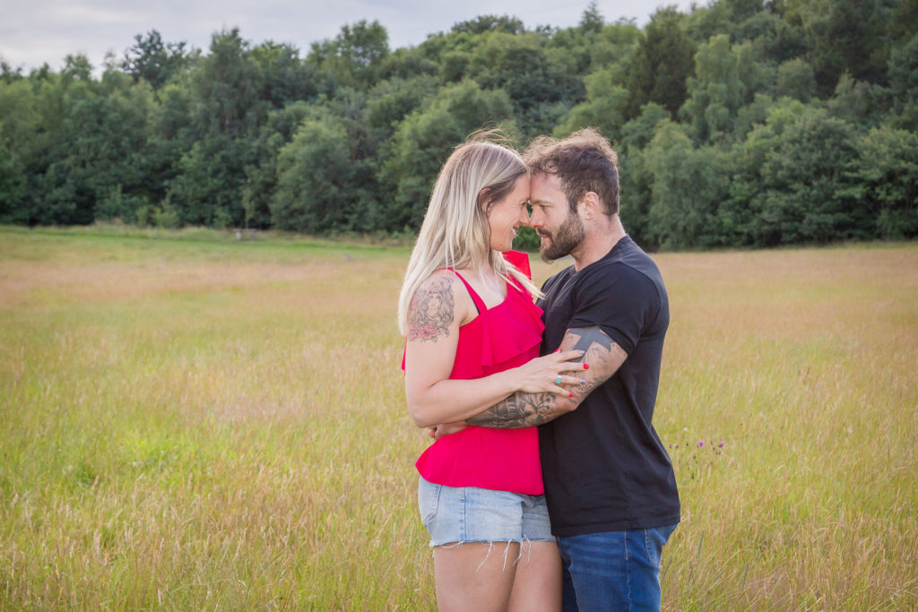 Couple in poppy field photoshoot