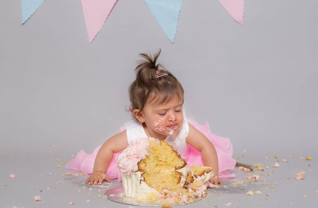 Baby girl enjoying a cake smashing session