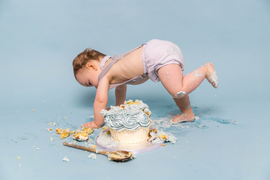 A baby smashes a cake during a photoshoot in Yorkshire