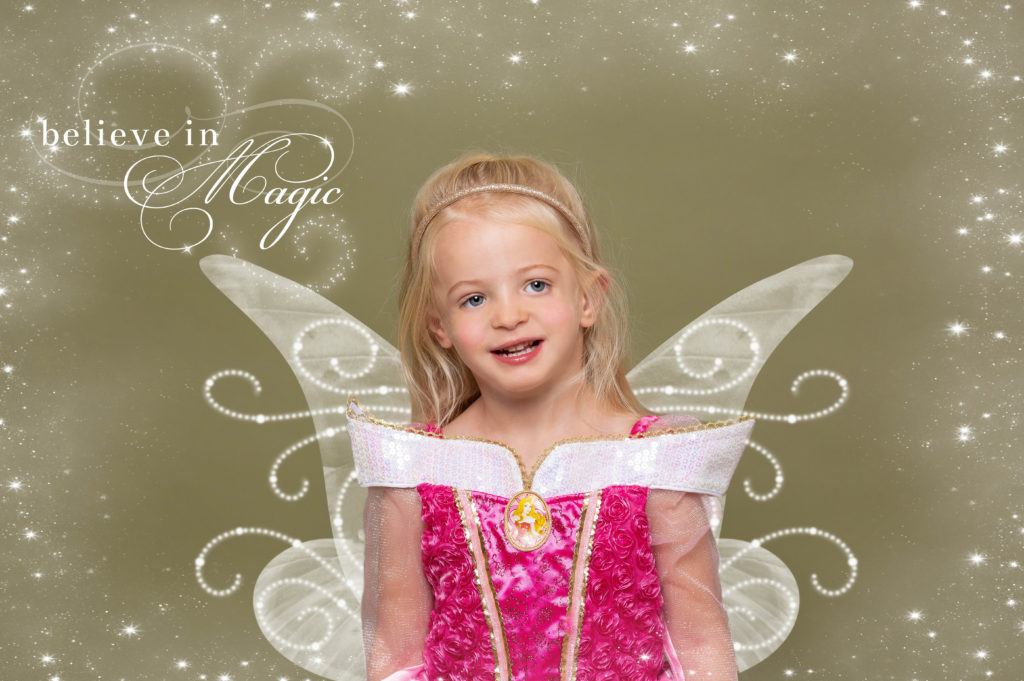 Girl smiling as a fairy in pink