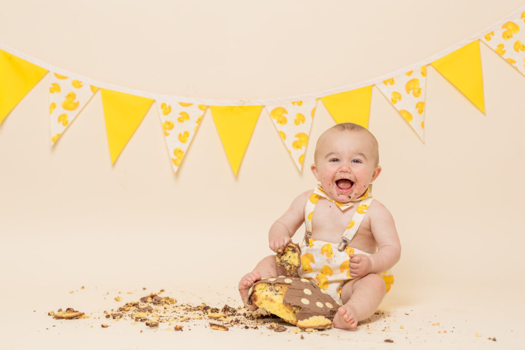 A baby with a cake during a photoshoot in west Yorkshire