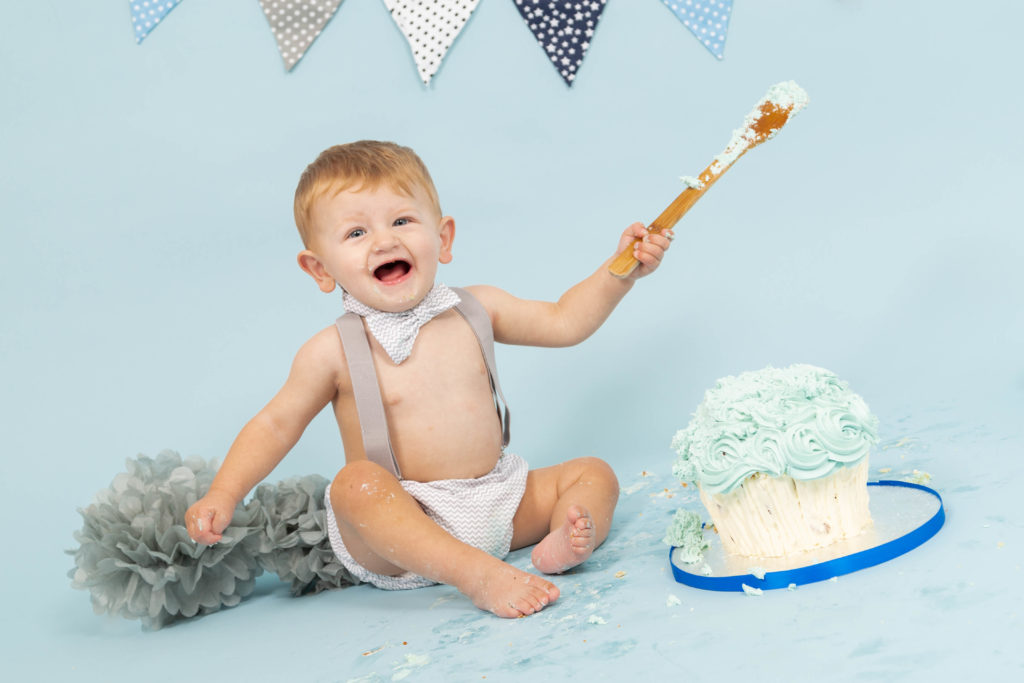 A baby smashes a cake during a photoshoot in west Yorkshire