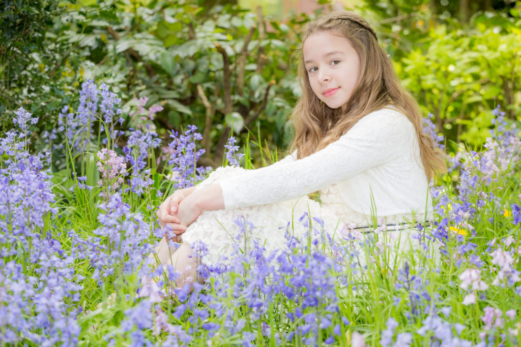 Young girl posing in bluebells