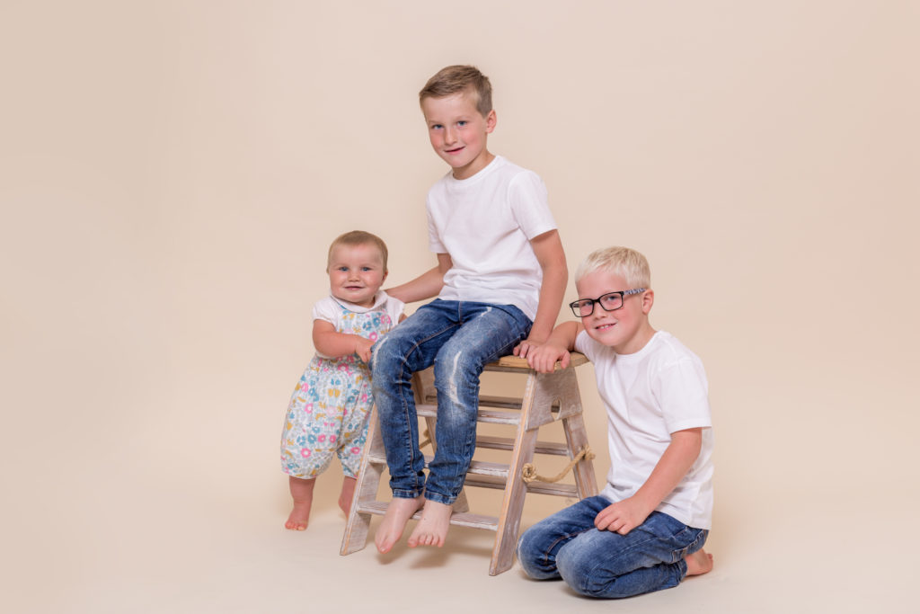Brothers pose beside some steps during a studio photoshoot in West Yorkshire
