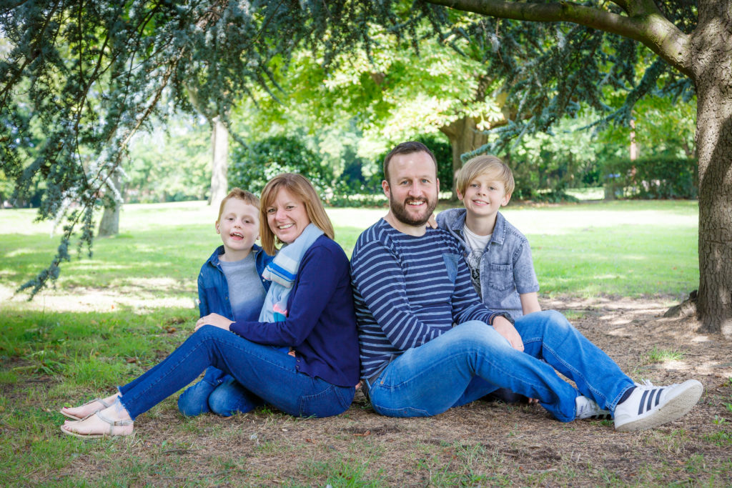 A family poses in the park for a photoshoot in West Yorkshire