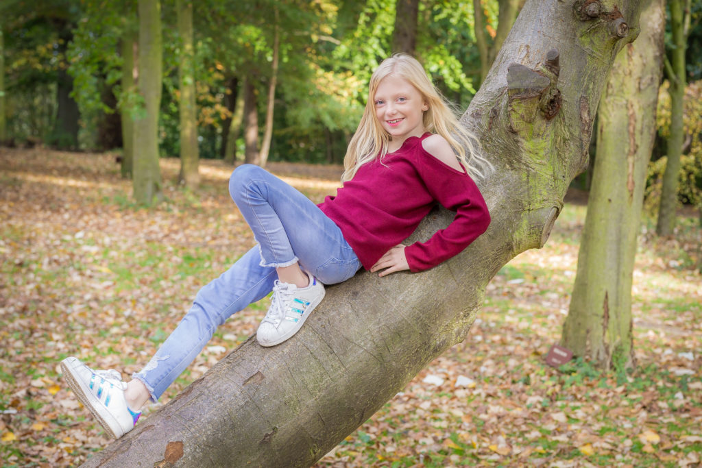 Girl poses in tree for photoshoot in the park in West Yorkshire