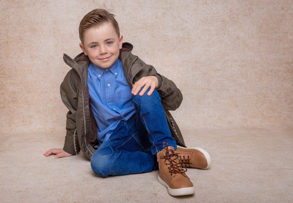 Boy poses for a studio photoshoot in West Yorkshire