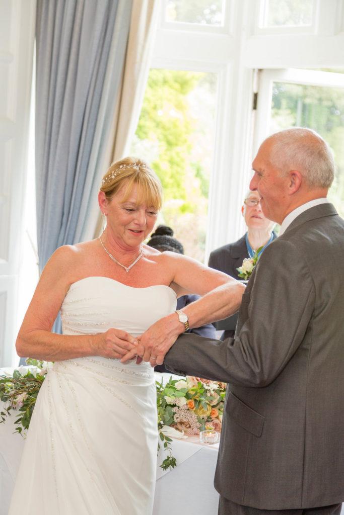 Bride struggles to place ring on her groom's finger