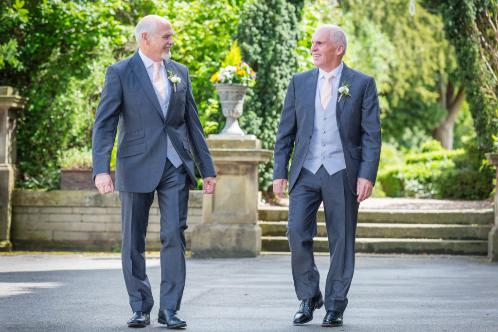 Groom and Best Man strolling in the sunshine
