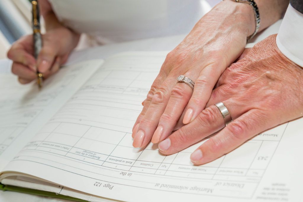 Bride and Groom's hands on the marriage register