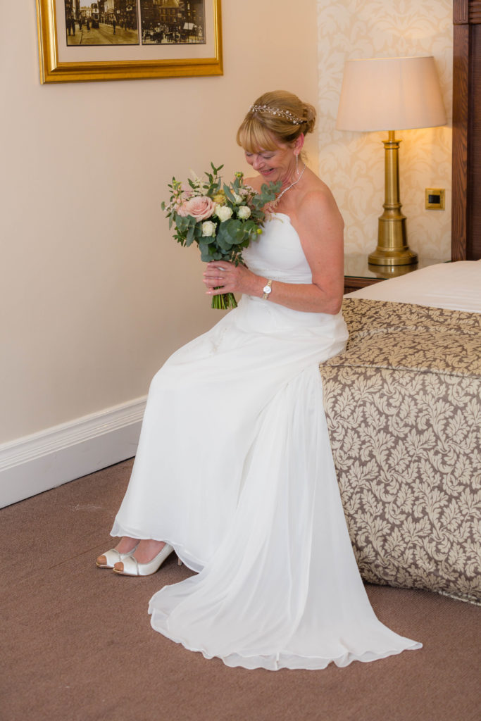 A bride awaits her wedding ceremony